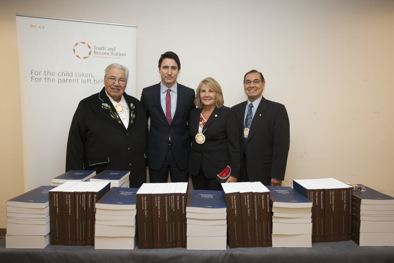 TRC reports on table in front of Commissioners and Prime Minister