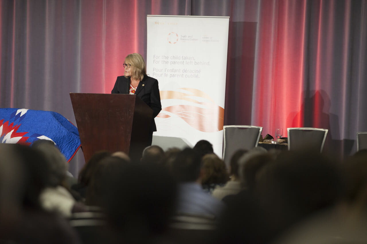Person speaking at TRC of Canada's Closing Ceremony