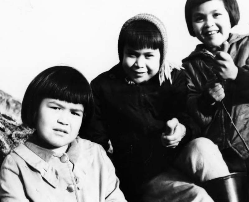 Three students posing for picture