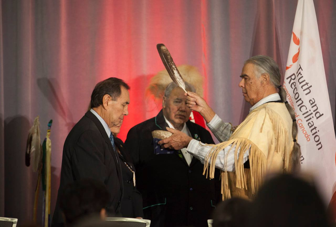 Four people on stage at TRC closing ceremony