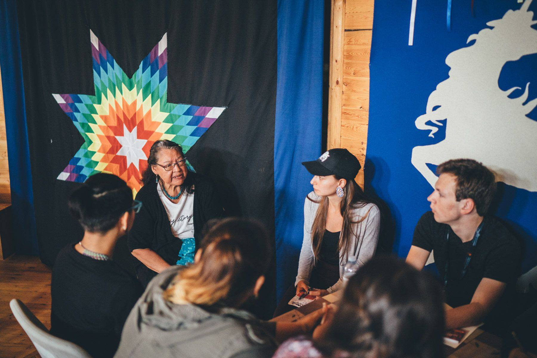 Group of people talking at Imagine a Canada event